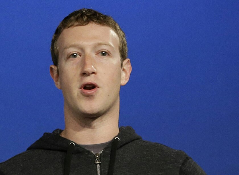 FILE - In this Thursday, March 20, 2013 file photo, Facebook CEO Mark Zuckerberg speaks at Facebook headquarters in Menlo Park, Calif. Zuckerberg gave $992.2 million to the Silicon Valley Community Foundation in 2013. Philanthropy in 2013 made a comeback in large donations with the nation's wealthi