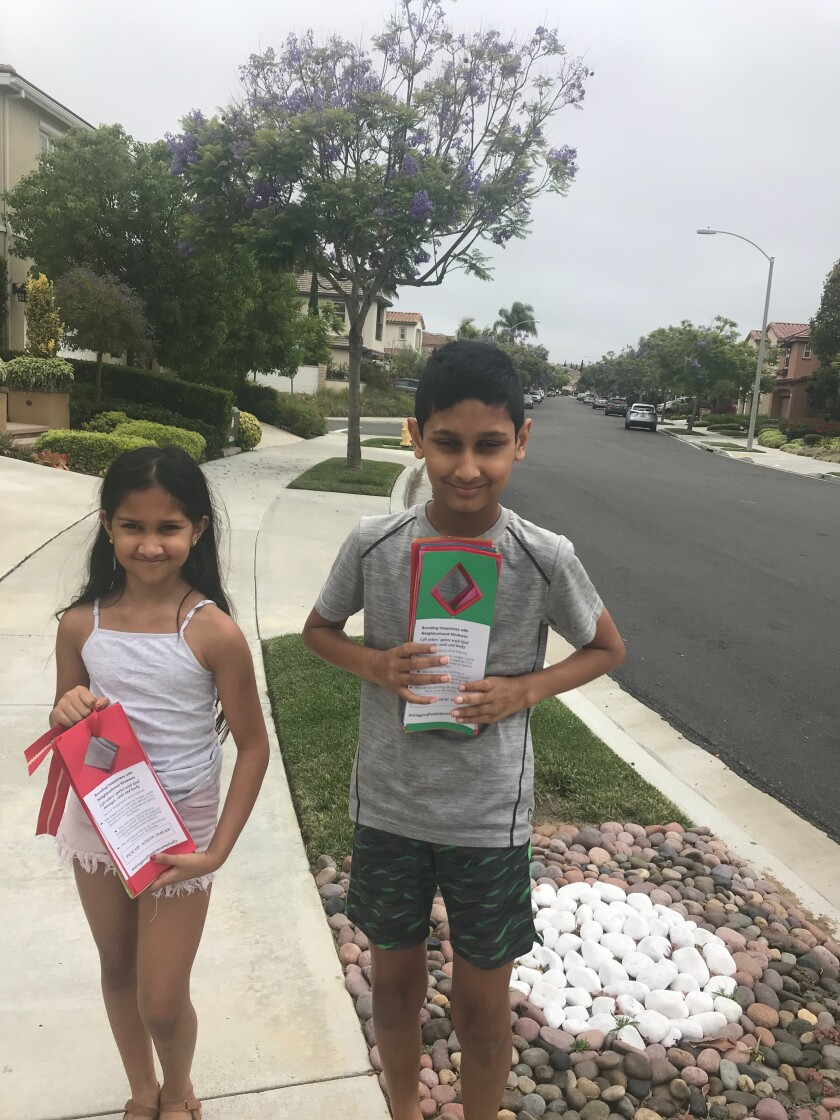 Maya and Dhruv Bantval distributed flyers for their drive in their neighborhood.