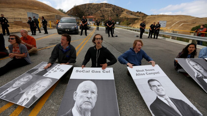 """Dozens of demonstrators chant """"shut it all down"""" as they protest outside the Aliso Canyon Storage Facility in Porter Ranch on May 15."""