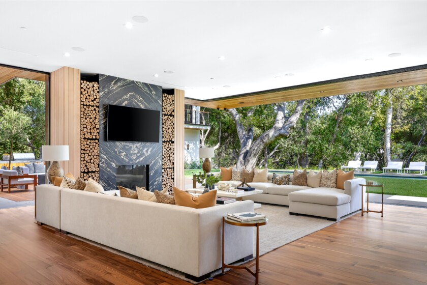 Built in 2019, the modern mansion is filled with glass, imported stone and aged natural wood.