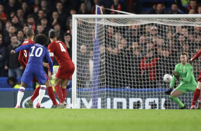 Chelsea's Willian, second left, kicks the ball to score has team's first goal during the English FA Cup fifth round soccer match between Chelsea and Liverpool at Stamford Bridge stadium in London Wednesday, March 4, 2020. (AP Photo/Kirsty Wigglesworth)