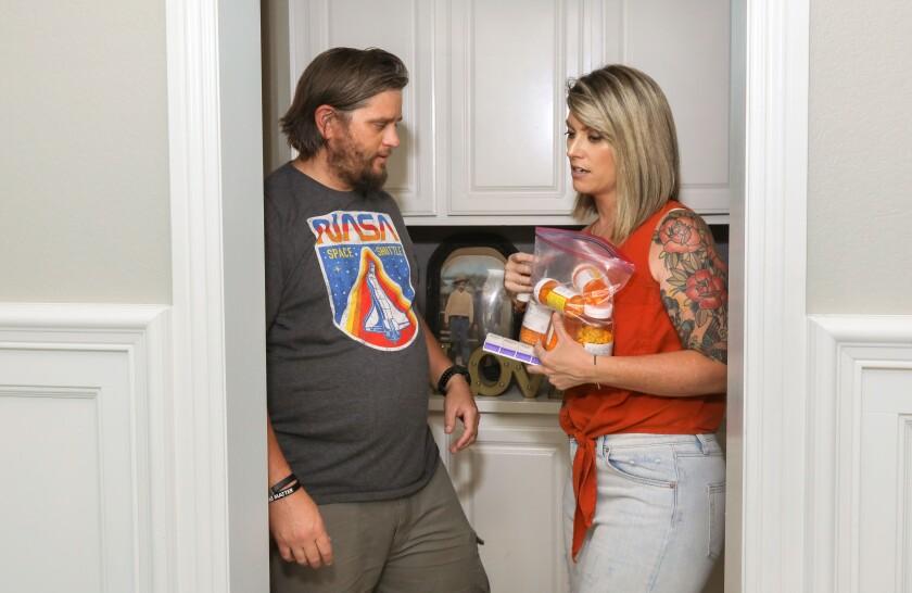Nikki Stephens and husband John gather his medications