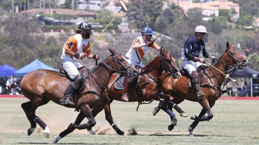 Polo players take the field during Aloha Sunday at the San Diego Polo Club Sunday, a fundraiser for