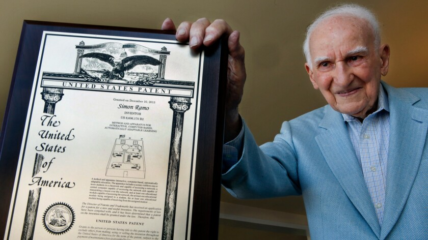 Simon Ramo poses with a mock-up of his final patent, issued to him at age 100 in 2013.