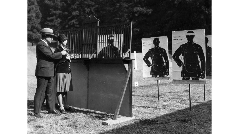 Feb. 18, 1928: Los Angeles Police Chief James Davis, left, with First National Bank teller Madeline Morneau at the police shooting range in Elysian Park.