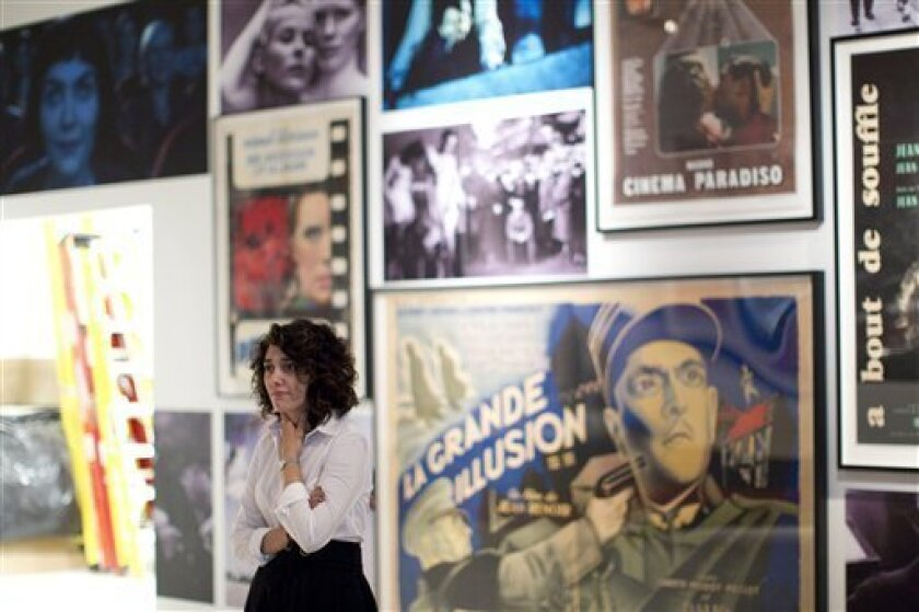 """In this Sept. 7, 2010 photo, a woman looks over the """"Essential Cinema"""" exhibition at the Bell Lightbox  in Toronto as  finishing touches are applied to the film centre and exhibition space. (AP Photo/The Canadian Press, Chris Young)"""