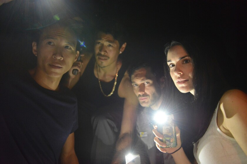 """Chris Dinh, left to right, Tim Chiou, Chris Riedell and Katie Savoy in the horror movie """"Crush the Skull."""""""
