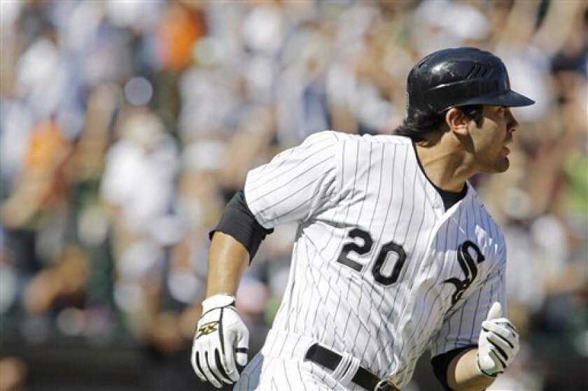 Chicago White Sox's Carlos Quentin watches his three-run home run against the Texas Rangers during the eighth inning of a baseball game Wednesday, July 23, 2008, in Chicago. (AP Photo/M. Spencer Green)