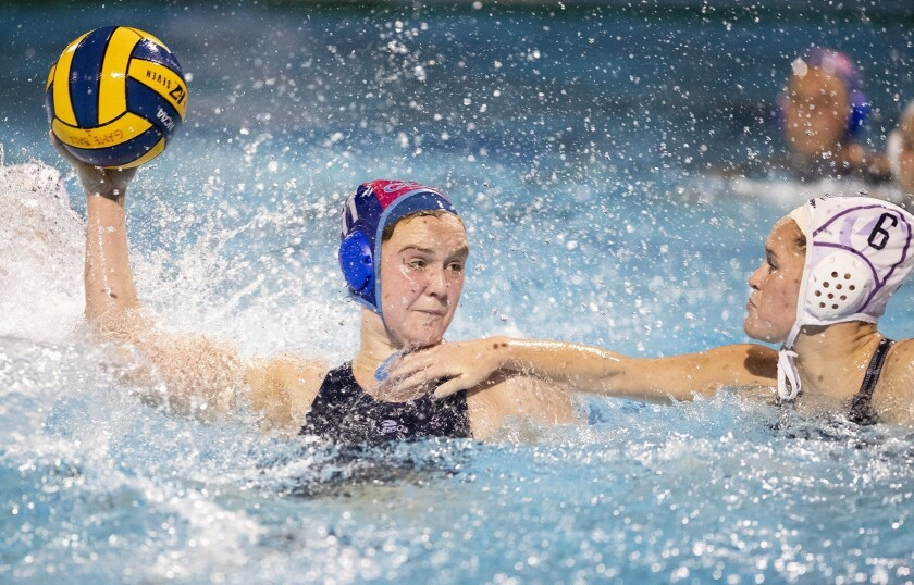 Corona del Mar's Sophie Wallace takes a shot against Carlsbad's Fiona Schmidt during a first round C