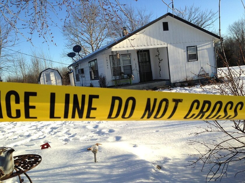 Police tape surrounds one of the crime scenes in Tyrone, Mo., on Friday. A shooting rampage left eight dead.