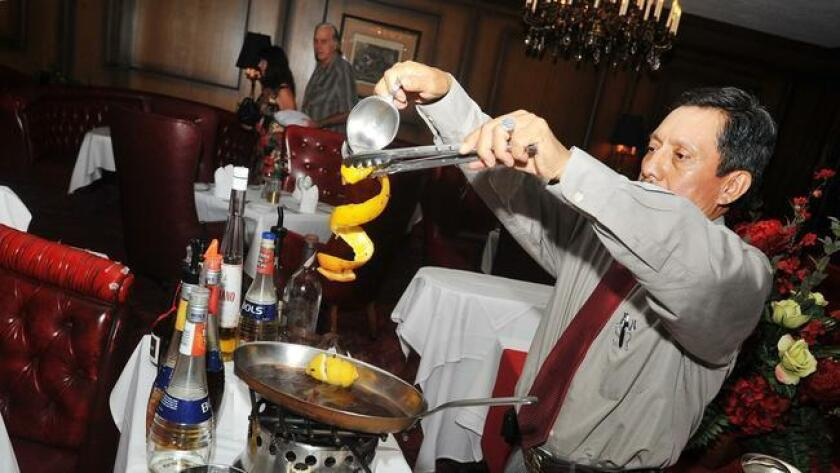 Bartender Felipe Trujillo prepares Flambe Cafe Diablo tableside at Imperial House Continental Restaurant/Lounge in Bankers Hill.