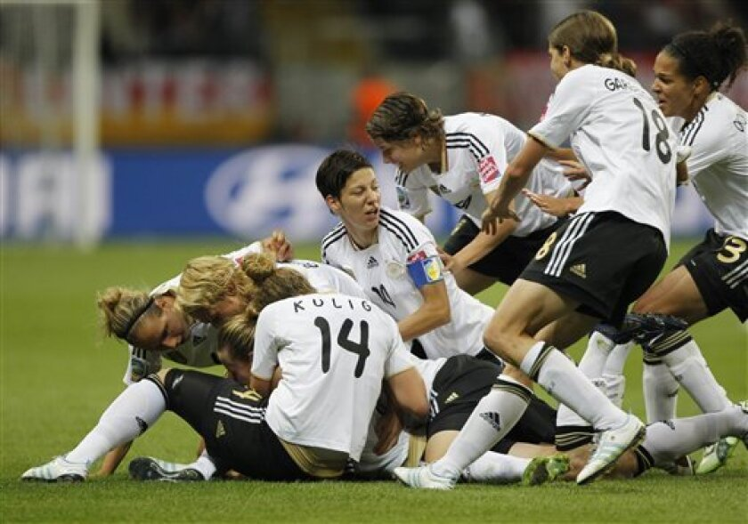 German team celebrate after Germany's Simone Laudehr, hidden, scored the opening goal during the group A match between Germany and Nigeria at the Women's Soccer World Cup in Frankfurt, Germany, Thursday, June 30, 2011. (AP Photo/Matthias Schrader)