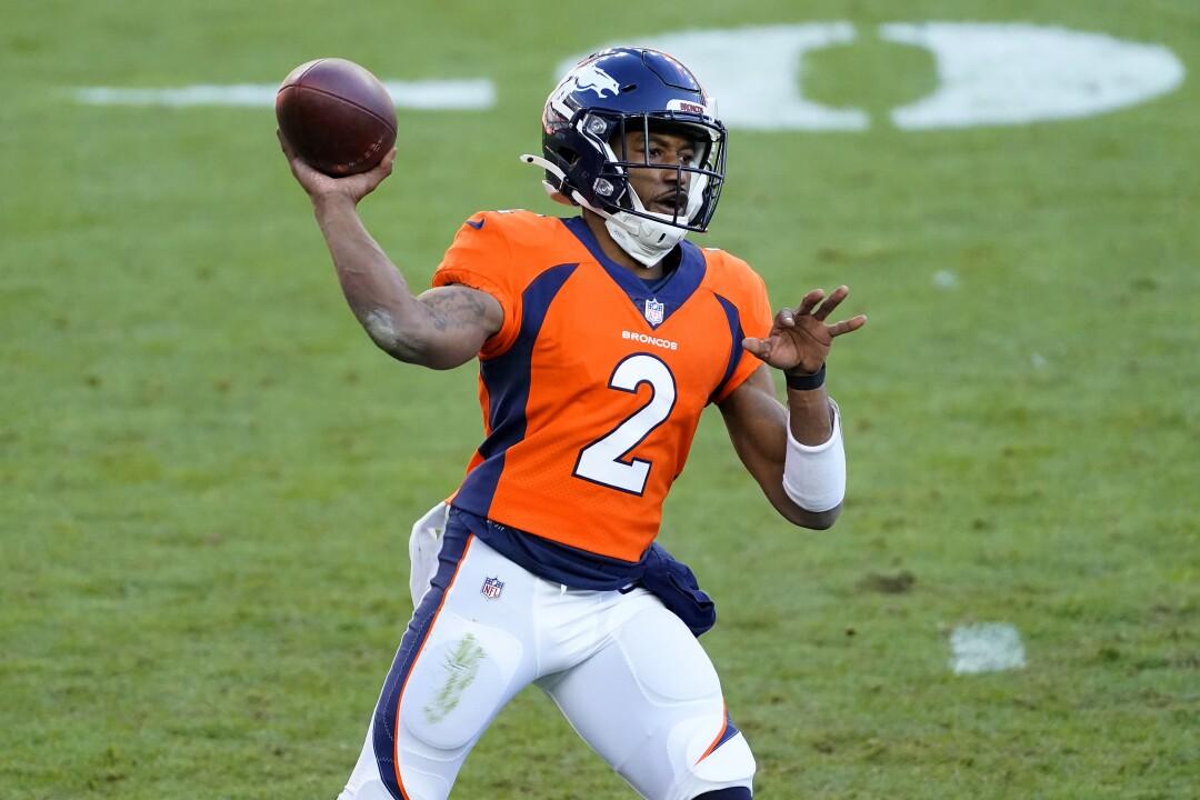 Denver Broncos quarterback Kendall Hinton throws against the New Orleans Saints in November.