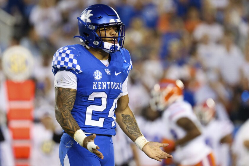 Kentucky running back Chris Rodriguez Jr. (24) complains about a call during the second half of an NCAA college football game against Florida in Lexington, Ky., Saturday, Oct. 2, 2021. (AP Photo/Michael Clubb)