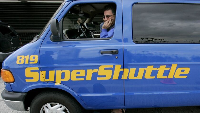In a party-line vote, Republican members of the National Labor Relations Board sided against SuperShuttle van drivers who were seeking to unionize. Above, a SuperShuttle driver in 2005.
