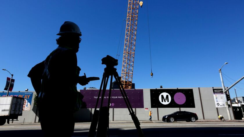 Crews work on the first phase of the Metro Purple Line extension at the corner of Wilshire Boulevard and La Brea Avenue.