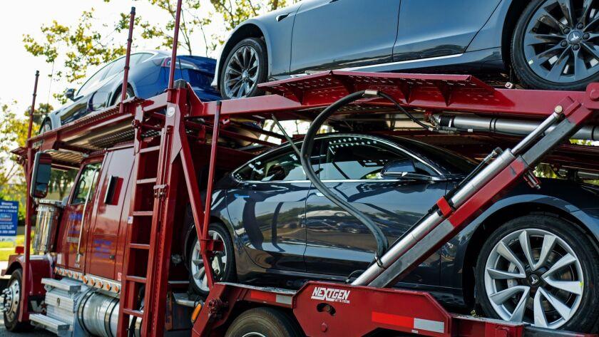 Tesla cars on their way to customers.