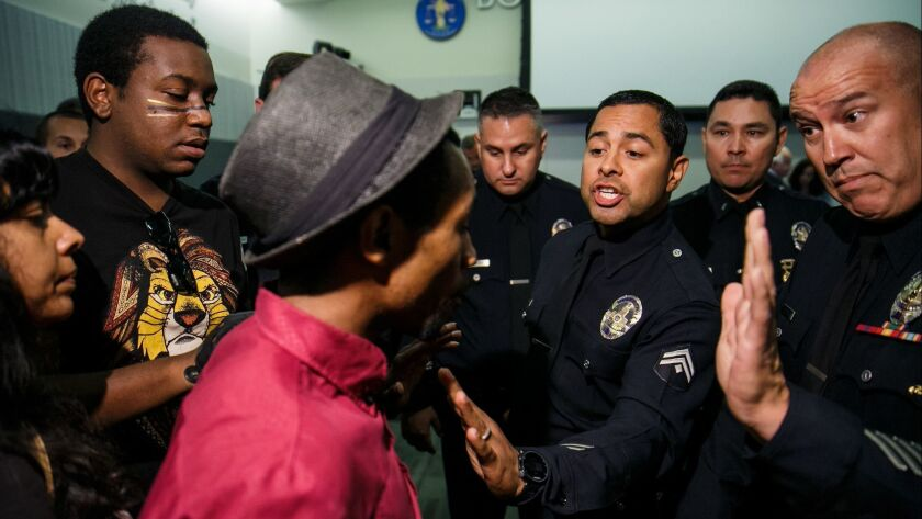 Protesters interrupt the LA Board of Police Commissioners meeting in Los Angeles, on July 25, 2017.