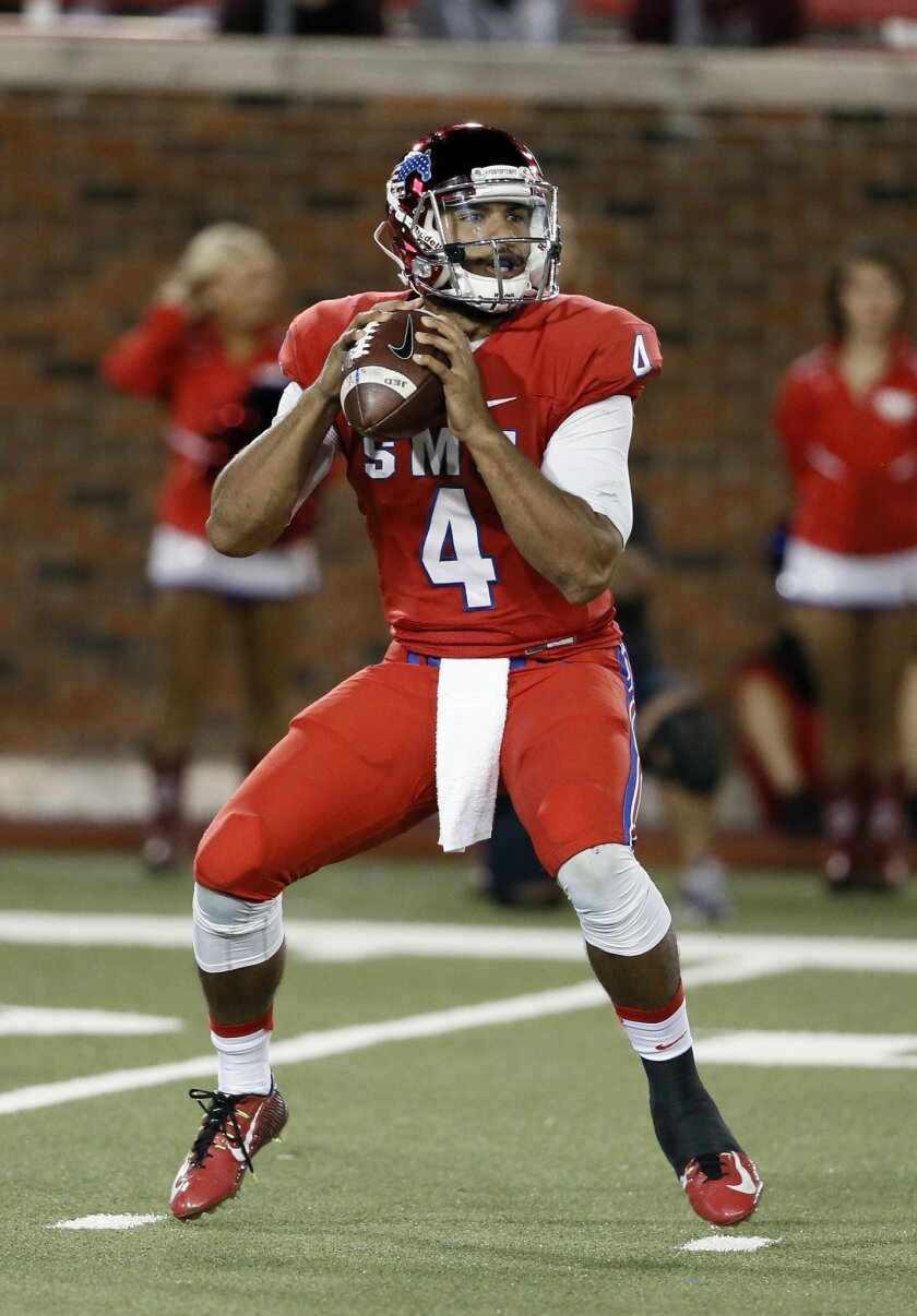 SMU quarterback Matt Davis (4) drops back to pass in the first half of an NCAA college football game against Temple, Friday, Nov. 6, 2015, in Dallas. (AP Photo/Tony Gutierrez)