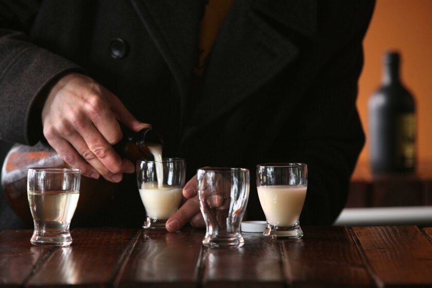 Chuck Perkins pours sake at Kuracali in San Marcos. The entrepreneur has opened a sake brewery — the first in the county — in a San Marcos industrial park.