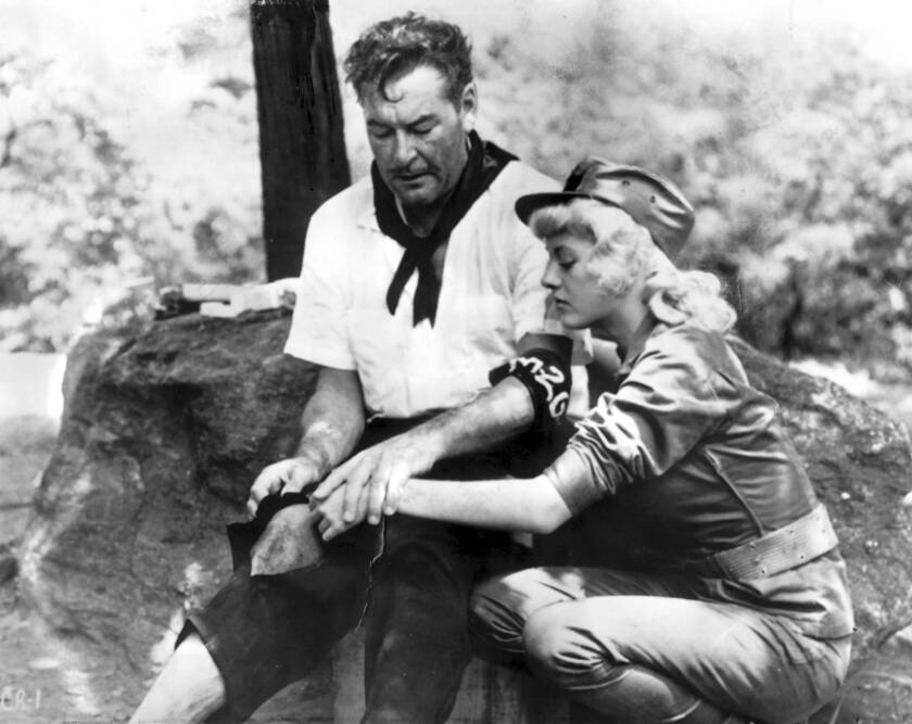 "Errol Flynn in a scene from his last movie , ""Cuban Rebel Girls,"" with Beverly Aadland, his protegee."