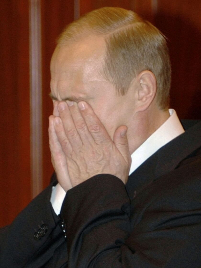 Russian President Vladimir Putin reacts to the news that scores of hostages had died as special forces stormed a Moscow theater and freed hundreds of others held by Chechen rebels.