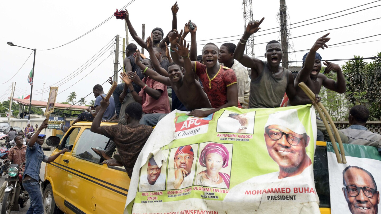 Supporters of newly elected Nigerian President Muhammadu Buhari celebrate in Lagos on Wednesday.