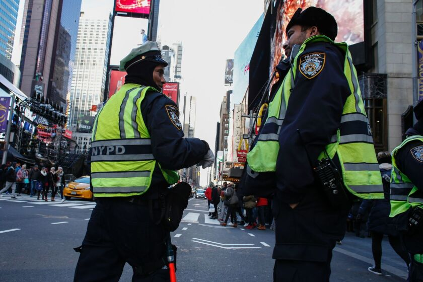 Police officers patrol Times Square on Dec. 30 as New York City prepares to welcome nearly 2 million people for New Year's Eve celebrations.
