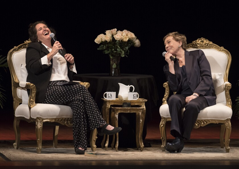 Times columnist Mary McNamara, left and laughing, seated onstage at the Orpheum with Julie Andrews, both holding microphones.