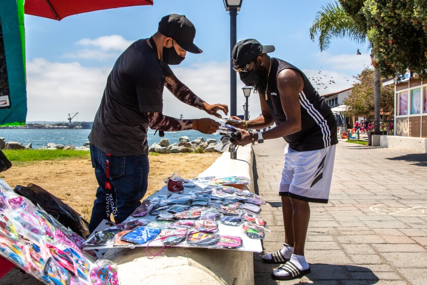 Luis Lopez sells handmade masks in Seaport Village