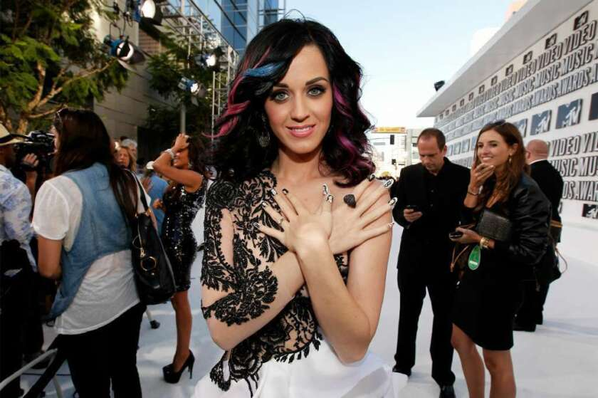 Katy Perry poses for the press in a skin-baring dress.