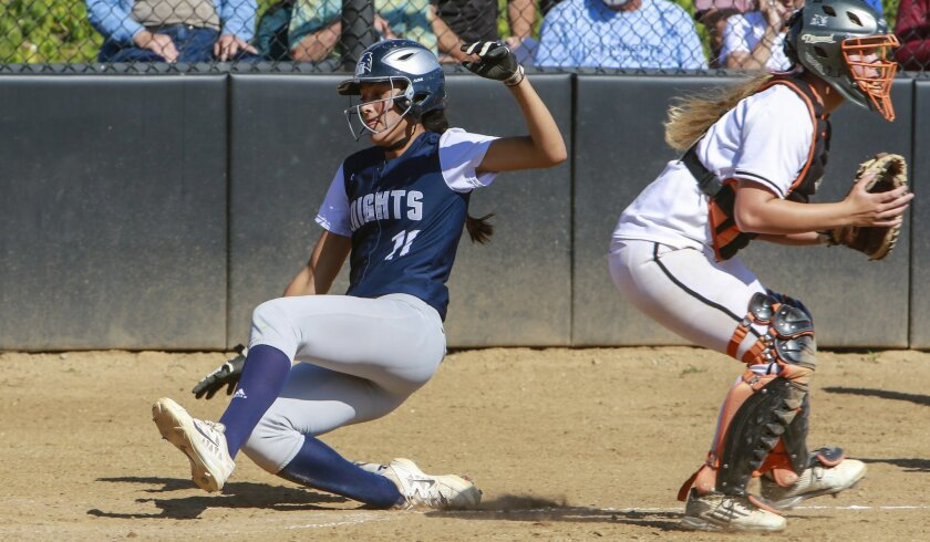 San Marcos' Alexis Orozco, who slides in with a run, played a key role for the top-ranked Knights this season.