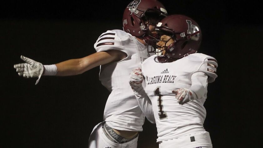 Laguna Beach High wide receiver Sean Nolan, left, celebrates his second touchdown with teammate Raul