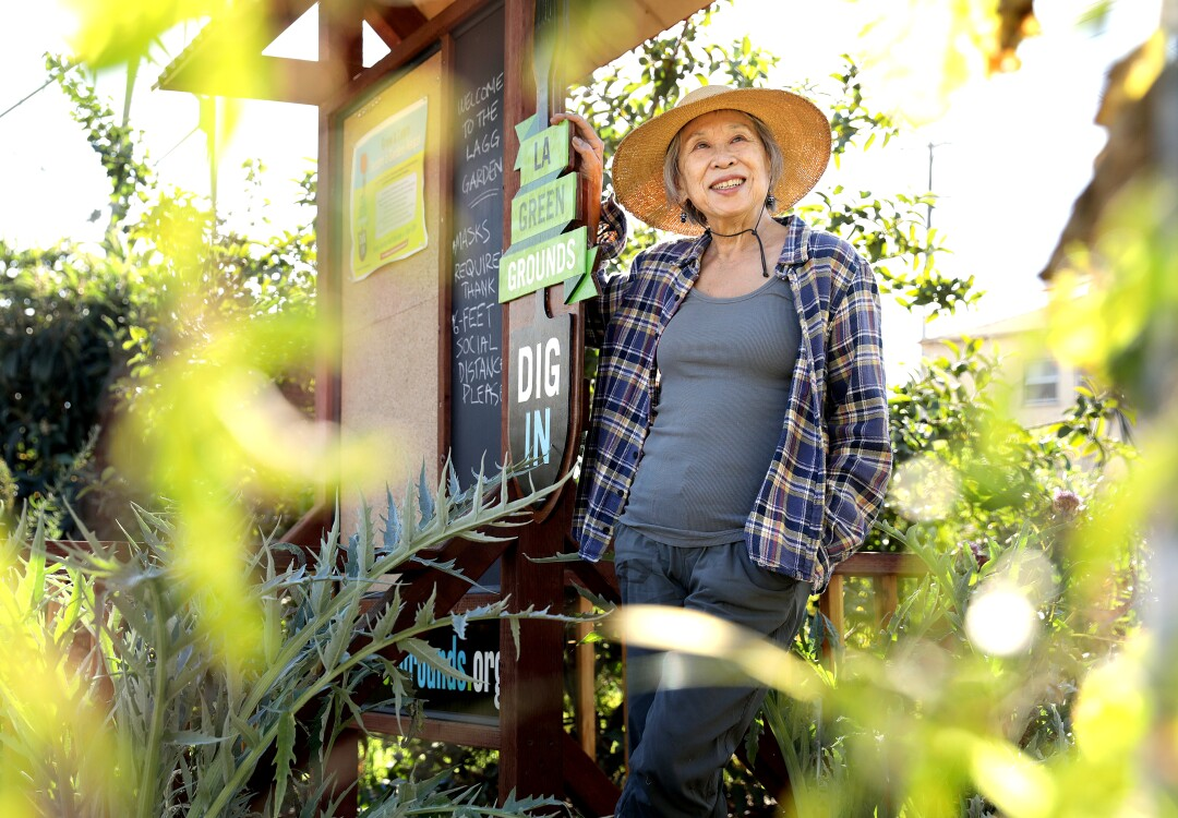 Florence Nishida wears a straw hat at L.A. Green Grounds Garden.