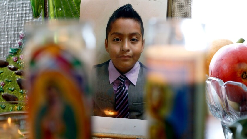 A shrine to Jesse Romero at his home in Boyle Heights. Romero, 14, was fatally shot in 2016 by an L.A. police officer who had shot a man to death 12 days earlier.