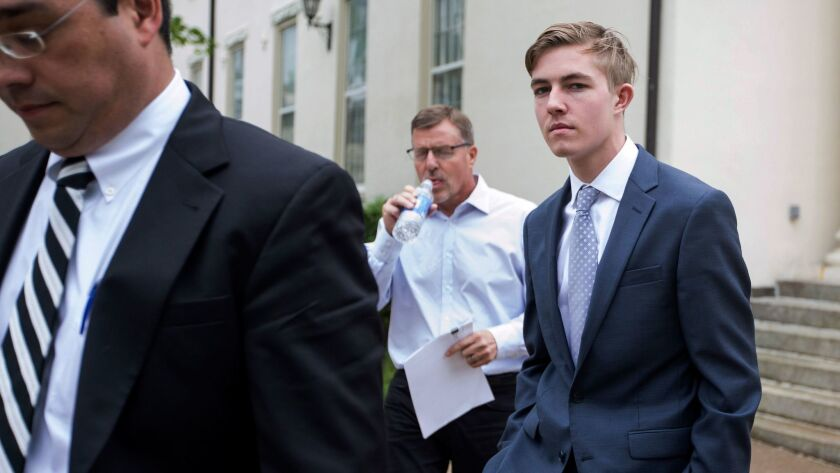 In this Friday, May 5, 2017 photo, Luke Visser, of Encinitas, leaves Centre County Courthouse in Bellefonte, Pa. Visser is one of 18 Penn State Beta Theta Pi fraternity members charged in connection with the February 2017 death of Timothy Piazza.