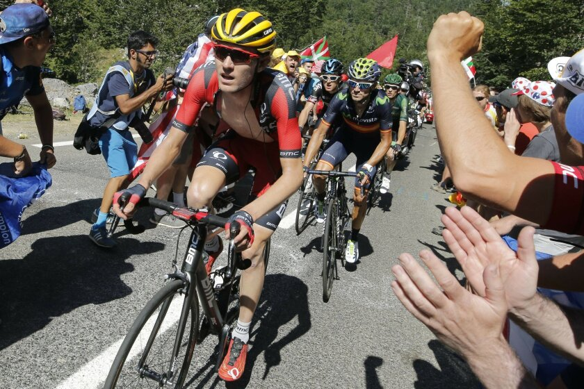 FILE- In this July 14, 2015, file photo, Tejay van Garderen of the U.S., front, climbs towards La Pierre-Saint-Martin during the tenth stage of the Tour de France cycling race over 167 kilometers (103.8 miles) with start in Tarbes and finish in La Pierre-Saint-Martin, France. Van Garderen, who was third overall in the Tour de France a year ago, will join four other Americans on the start line Saturday, July 2, 2016 in Mont-Saint-Michel. (AP Photo/Laurent Cipriani)