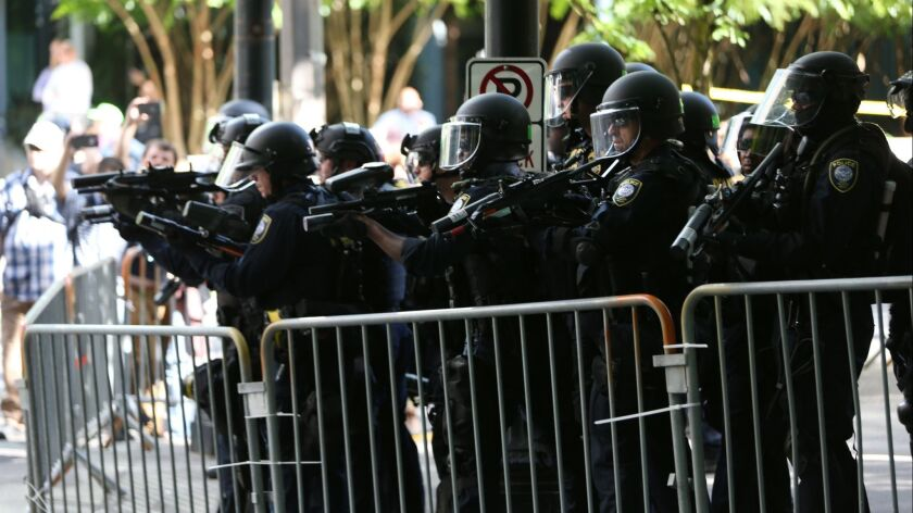 Police disperse clashing protesters after violence erupted when two opposing protest groups took to the streets in Portland, Ore.