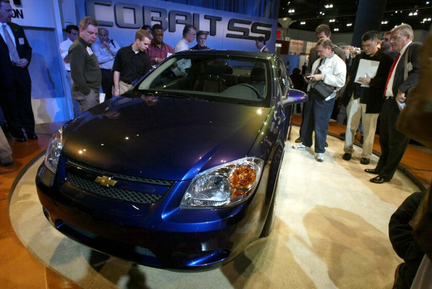 A new 2005 Chevrolet Cobalt is displayed at the Los Angeles Auto Show in 2003. The Cobalt is one of several GM models the company is recalling to fix an issue with the ignition switch that has caused some cars to accidentally shut off, leading to fatal crashes.