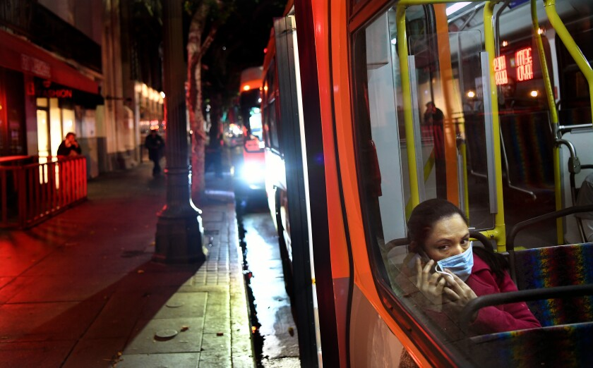 A passenger wears a mask on a Metro bus during the coronavirus outbreak in downtown Los Angeles.