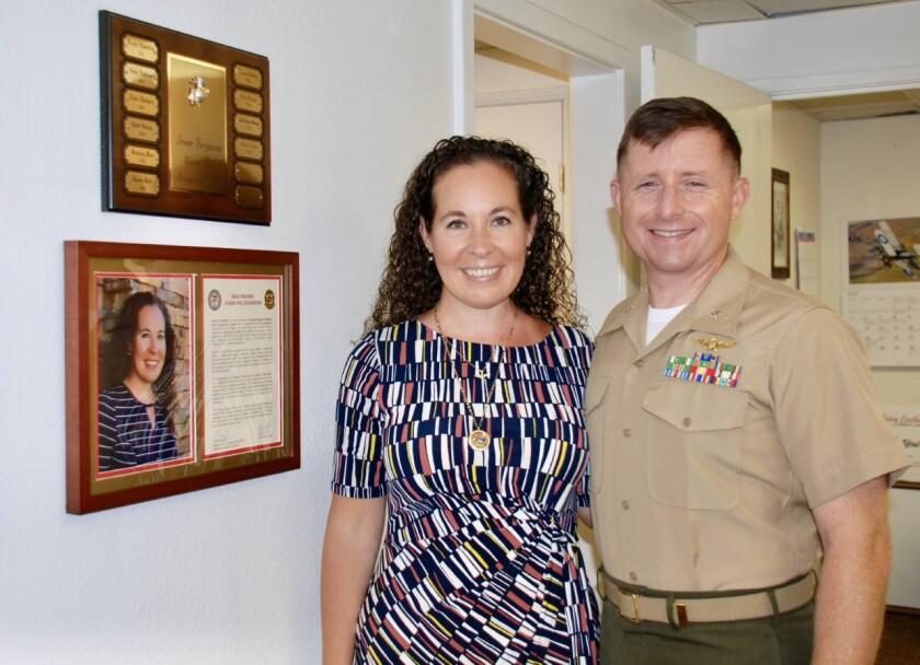 Kailee Norris, left, winner of the Irene Ferguson Marine Wife Recognition Award