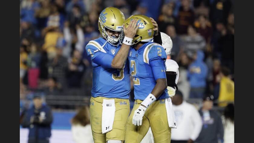 UCLA quarterback Josh Rosen hugs receiver Jordan Lasley after they hooked up on a fourth-quarter touchdown against Arizona State on Saturday.