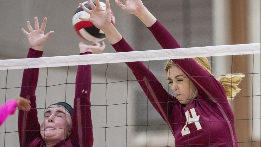 Ocean View's Cambria Adams, left, and Helen Reynolds attempt to block a shot from a Garden Grove pla