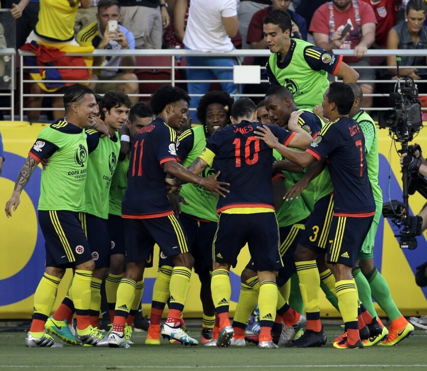 Colombia's James Rodriguez, center, celebrates with teammates after scoring a penalty kick against the U.S. during the opening match of the Copa America Centenario at Levi's Stadium in Santa Clara, Calif., Friday, June 3, 2016. (AP Photo/Jeff Chiu)