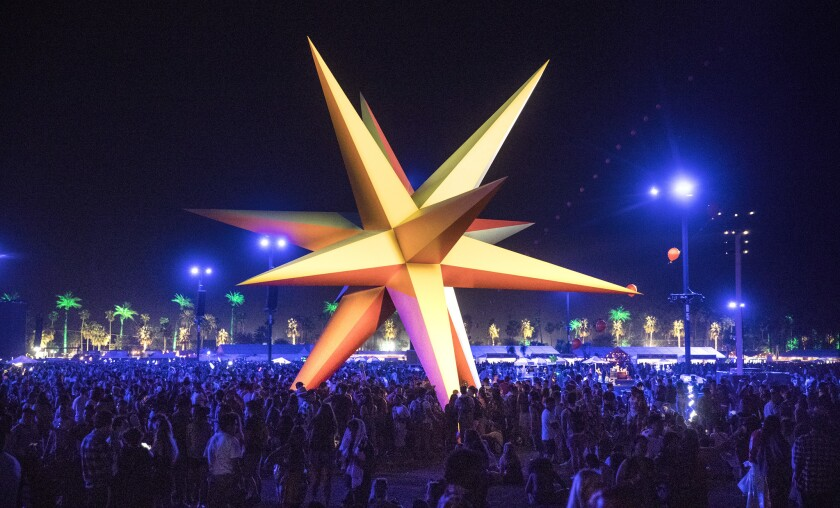Festival goers crowd around the Supernova, a polychromatic star during the 2018 Coachella Valley Music and Arts Festival
