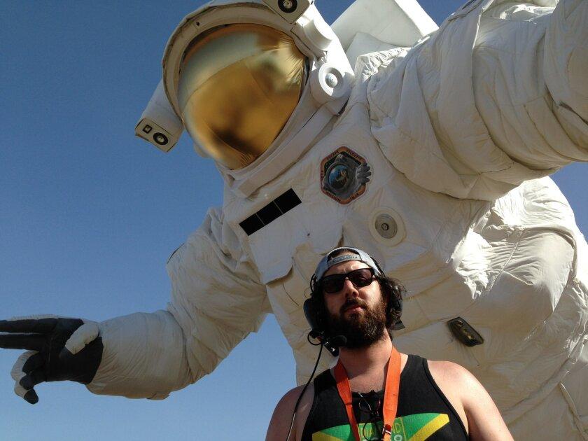 "Designer Nick Kinney, 28, poses in front of ""Escape Velocity PK 14."""