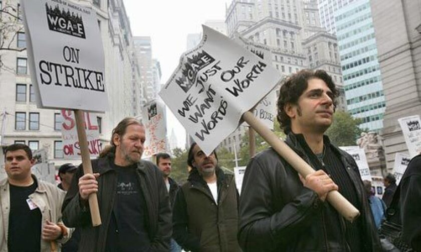 "The Writers Guild of America, East set up picket lines at the edge of Battery Park, a subway stop away from Wall Street but as close as municipal officials would let them get to the New York Stock Exchange and the iconic bronze sculpture of a bull. Supporters of the WGA strike included Michael Imperioli, right, who played Christopher on ""The Sopranos."""