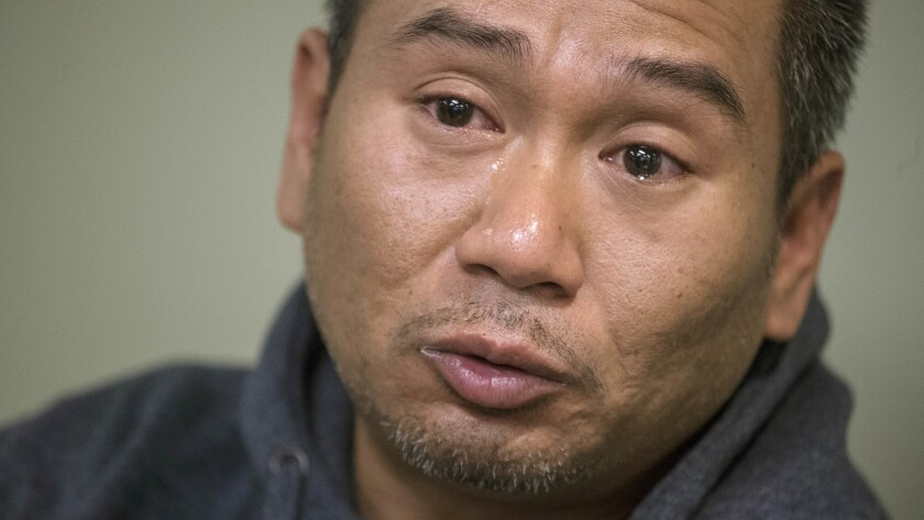 LOS ANGELES, CA -- WEDNESDAY, NOVEMBER 1: Tears roll down face ofCambodian refugee Posda Tout, cousi