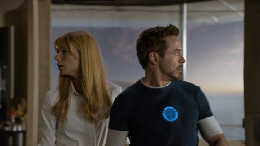"""Gwyneth Paltrow and Robert Downey Jr. star in """"Iron Man 3,"""" which crossed the $1 billion milestone at the worldwide box office on Thursday."""