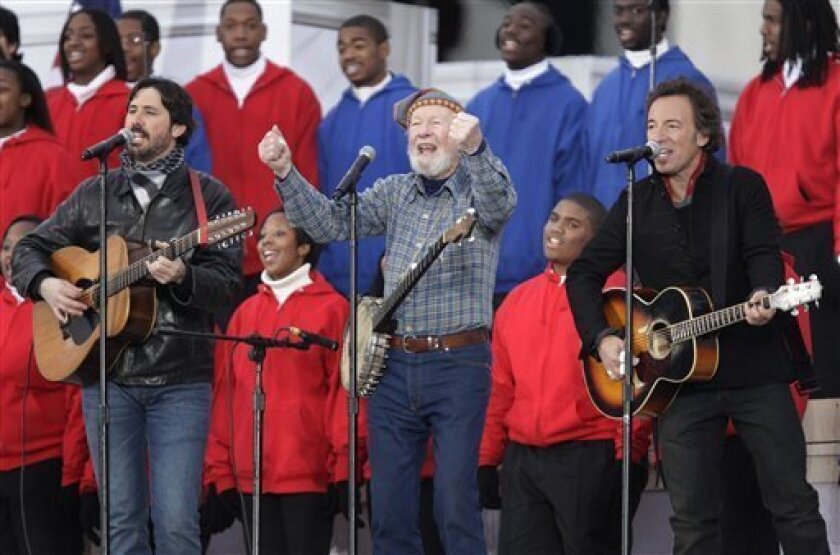 """Pete Seeger, center, Bruce Springsteen, right, and Seeger's grandson Tao Seeger, perform during the """" We Are One: Opening Inaugural Celebration at the Lincoln Memorial"""" in Washington, in this Jan. 18, 2009 file photo. It took 49 years but a San Diego school board member wants to apologize to Pete"""